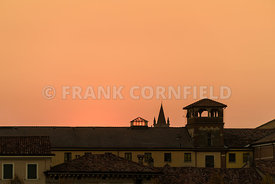 Graphic profile of the roof of the Castelvecchio Castle in Verona at sunset.