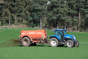 Slurry spreading a meadow in Cumbria, using a New Holland T6070 tractor. UK