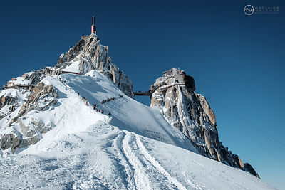 Alpinists on their way from Aguille  du Midi to the Vallée  Blanche. Chamonix, France.