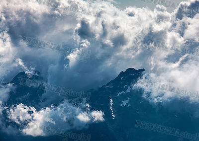 Clouds over the Mountains Peaks