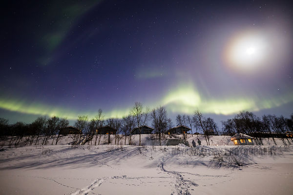 People photographing the Aurora on the shore of the Teno River in the far north of Finnish Lapland
