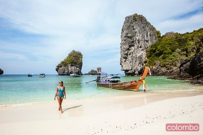Asian woman walking on beach, Ko Phi Phi island, Krabi, Thailand