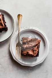Slice of chocolate cake, chocolate buttercream frosting