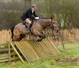 Ashley Bealby jumping a hunt jump at Peakes - The Fitzwilliam Hunt visit the Cottesmore at Burrough House