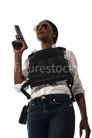 A tough woman, in a bullet proof vest – shot from low level.