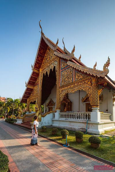 Female tourist at Wat Phra Singh, Chiang Mai, Thailand