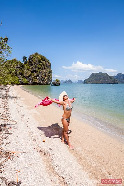Woman with sarong on tropical beach, Phang Nga bay, Thailand
