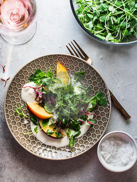 Ricotta salad with peaches and microgreens
