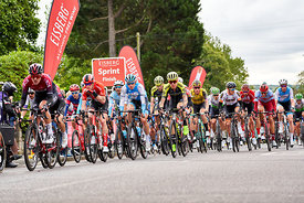 WHICKHAM, NEWCASTLE UPON TYNE, ENGLAND, UK - SEPTEMBER 09, 2019: The peloton crossing the first sprint points line of Stage 4...
