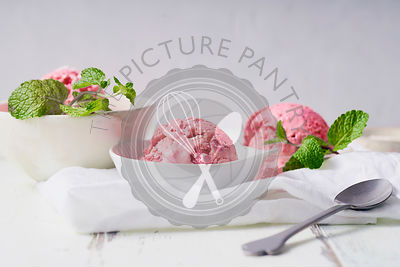 Pink ice cream with raspberries and red currants