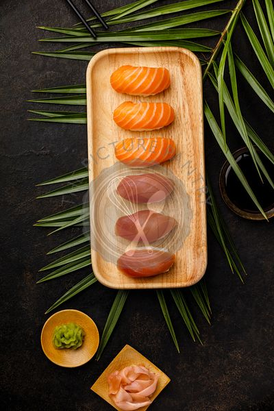 Nigiri sushi set with salmon and tuna served on bamboo plate