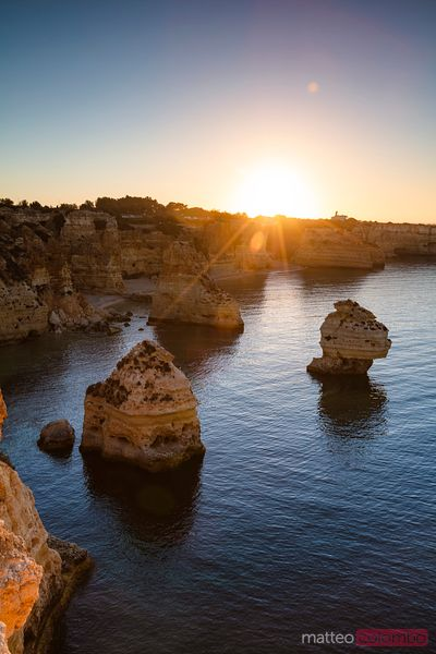 Rock formations and sea at sunrise, Algarve, Portugal