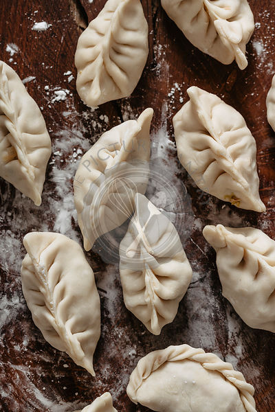 Raw dumplings filled with chicken
