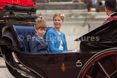 The children of Prince Edward, Lady Louise Windsor and James, Viscount Severn ride in an open carriage