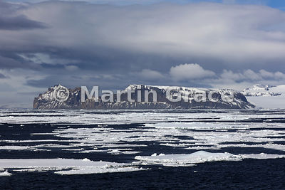 Weddell Sea landscape of ice, land, sea and cloudy sky, Antarctic Peninsula,  Antarctica