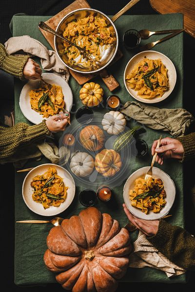 Flat-lay of Autumn dinner for gathering or Thanksgiving Day celebration