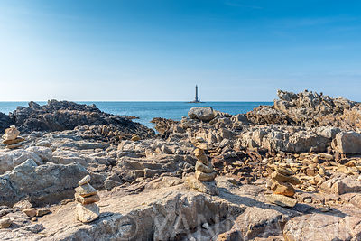 Cairns in front of Goury lighthouse, Cap de la Hague, France, Manche