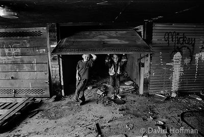 Children play in abandoned underground garages beneath the Ranwell Estate, Bow 1991.