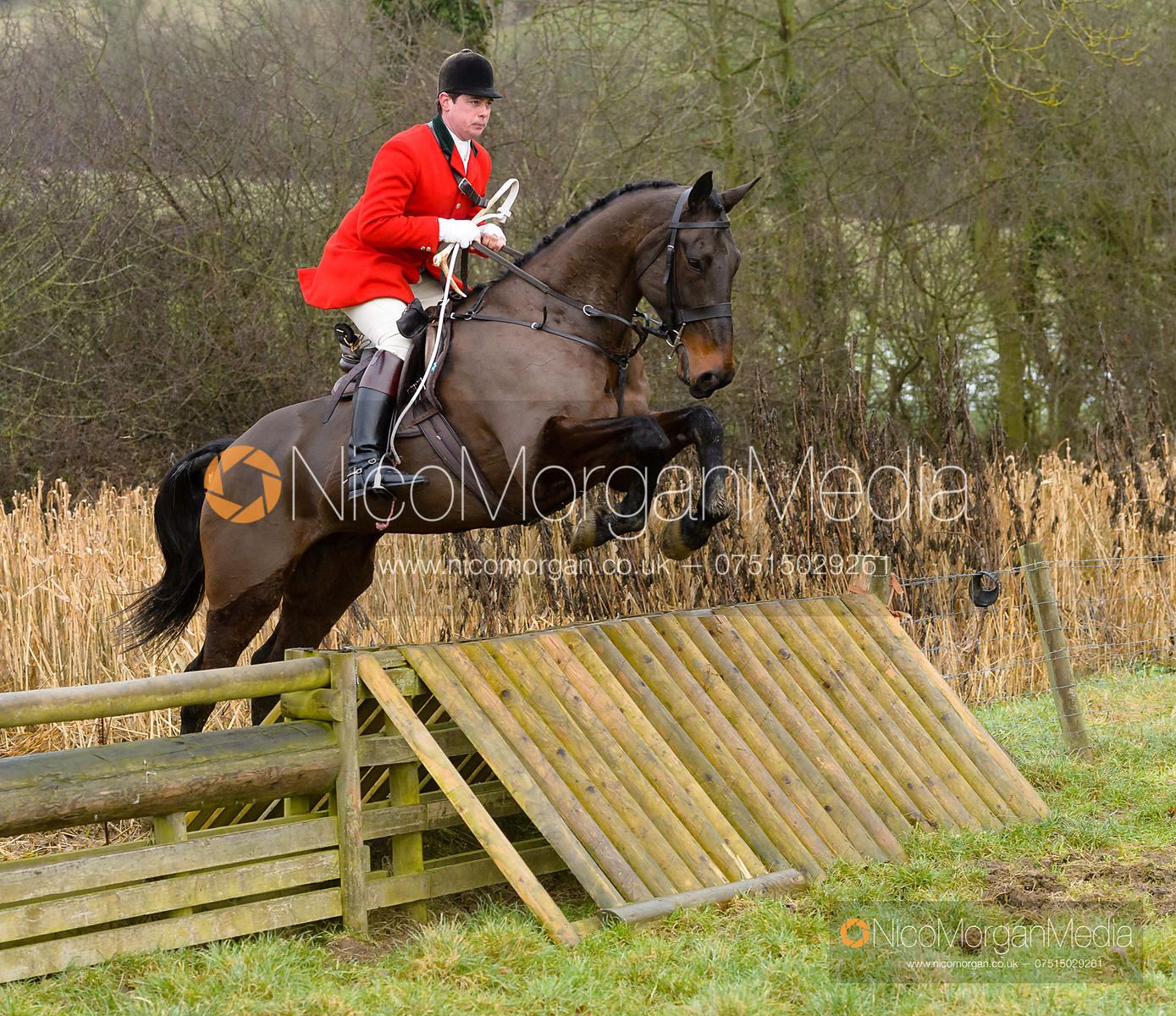 Simon Hunter jumping a hunt jump at Peakes - The Fitzwilliam Hunt visit the Cottesmore at Burrough House