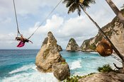 Woman enjoying a swing, Diamond beach, Nusa Penida, Bali