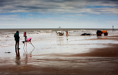 Artist and fisherman, Cromer Beach, North Norfolk.