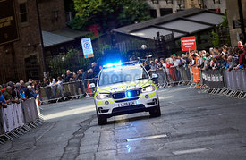 NEWCASTLE UPON TYNE, ENGLAND, UK - SEPTEMBER 09, 2019: Blue flashing lights on a Police car as it approachs the finishing lin...