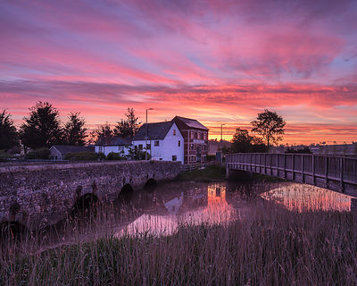 Dawn sky with two bridges over the River Clyst at Topsham, Devon, UK