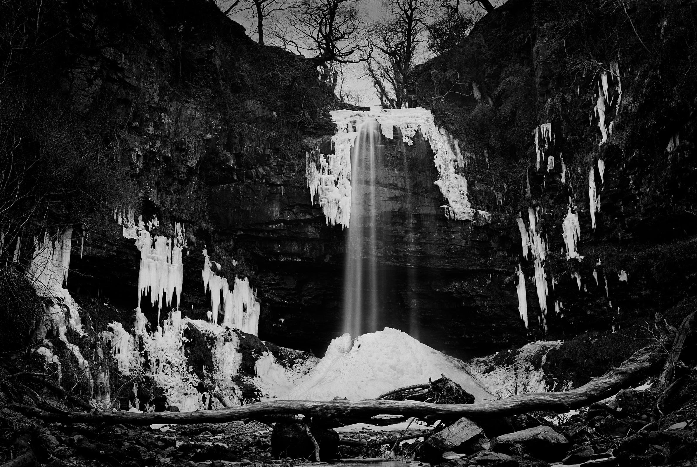 Henrhyd Waterfall, South Wales, in deep winter.