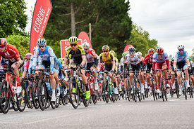 WHICKHAM, NEWCASTLE UPON TYNE, ENGLAND, UK - SEPTEMBER 09, 2019: Closeup of the peloton crossing the first sprint points line...