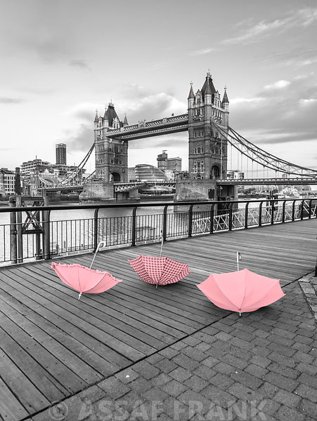 Pink umbrellas at Tower bridge, London, UK