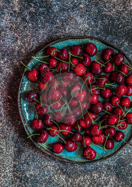 Cherries on green plate