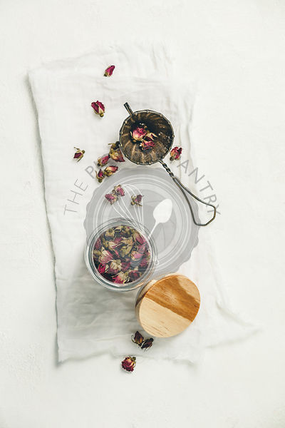 Dry rose buds tea in glass jar. Herbal tea, detox, health concept