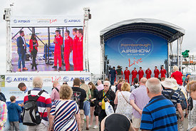 #120969,  Pilots from the RAF's Red Arrows display team being interviewed at the Farnborough Air Show, 2016.