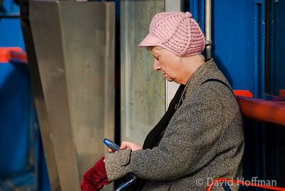 Elderly woman waiting on the platform for a Docklands Light Railway train