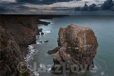 Sunrise at stack rocks, on dramatic coast of Pembrokeshire, South Wales, Uk