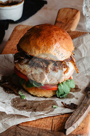 Turkey burger with vegetables on a wooden board perfect for thanksgiving