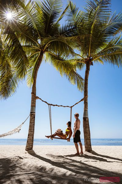 Couple on a swing, Panglao, Bohol, Philippines