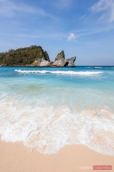Natural arch and beach, Nusa Penida, Bali, Indonesia