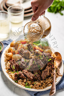 Beef Meat Pot Roast with a hand puring gravy