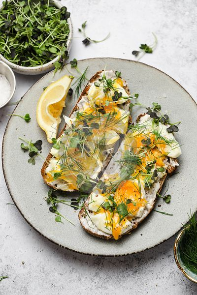 smashed 7 minute eggs on toast with herbs and mayonaisse