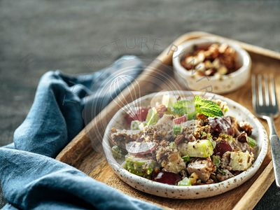 Waldorf salad on black, copy space, top view