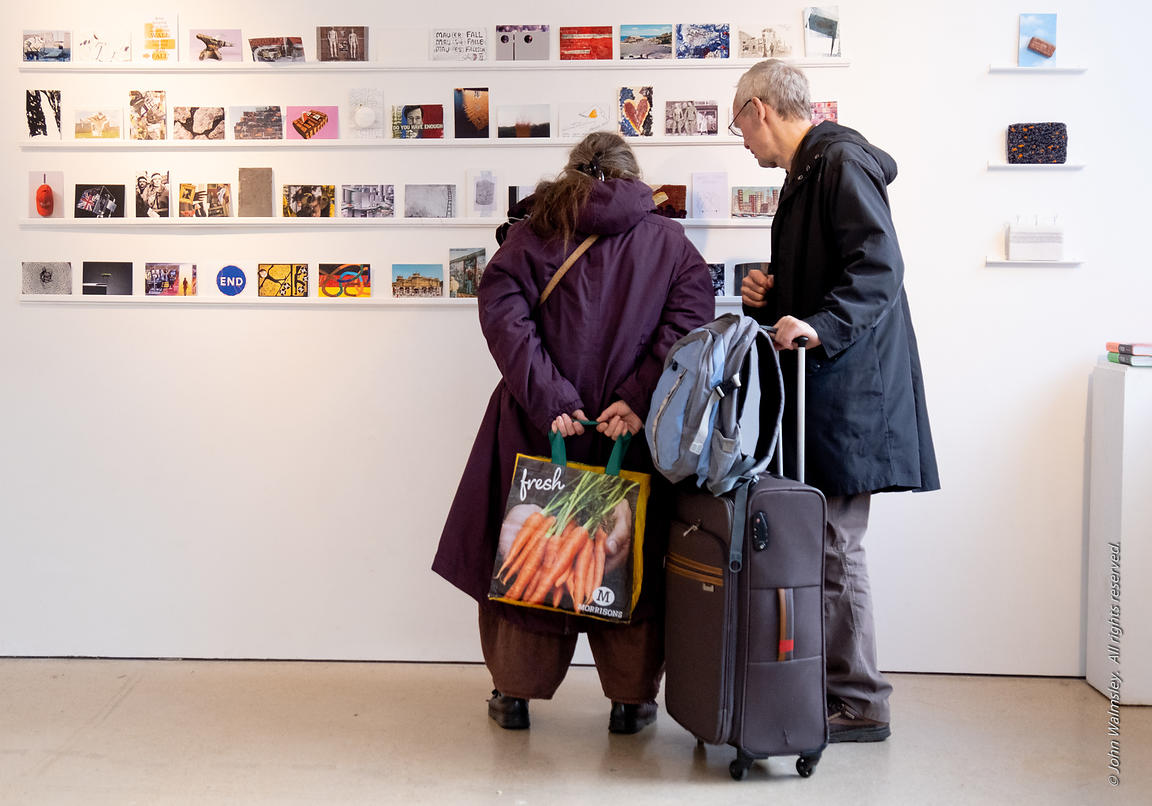 #125644,  People with baggage viewing artworks at the 'Falling Walls' exhibition, part of the 'Berliner Zeitgeist' project at...