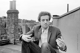 #74838,  Cornelius Cardew (1936-1981), avant-garde musician and composer, on the rooftops, Fitzrovia, London.  3rd July 1970.