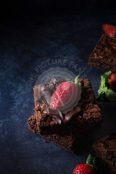 Chocolate brownies and strawberries.