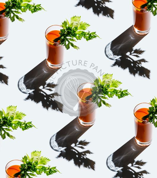 Carrot juice with celery on gray background Pattern