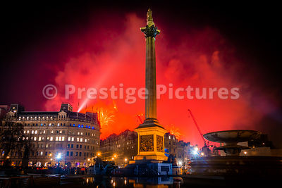 London Fireworks 2020 on News Years Eve as seen from Trafalgar Square - red sky
