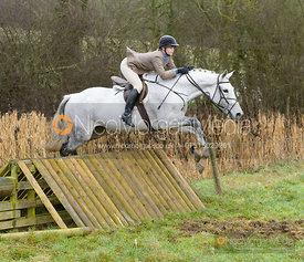 Lily Packe Drury Lowe jumping a hunt jump at Peakes - The Fitzwilliam Hunt visit the Cottesmore at Burrough House