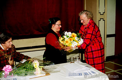 Anya Souza, a young woman with Downs syndrome, is presented with flowers following her presentation to the Newham Association...