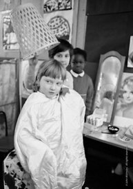 "#77334,  Dressing up at the ""Hairdresser"", Vittoria Primary School, Islington, London.  1970."
