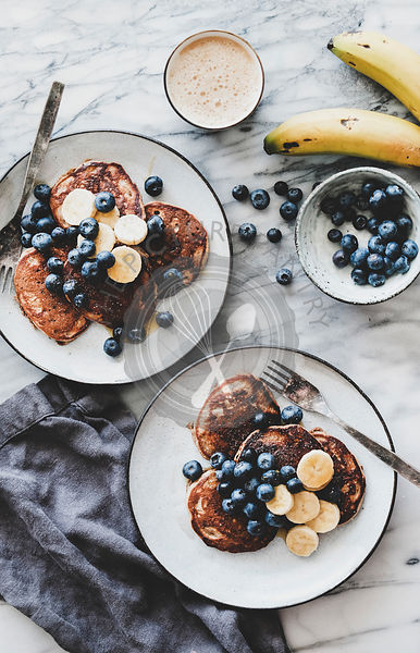 Healthy breakfast with banana pancakes and coffee, top view